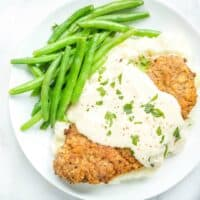 Chicken Fried Steak is classic comfort food of tender cube steak fried until golden and topped with creamy country gravy!