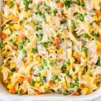 square image of chicken noodle casserole in a white baking dish