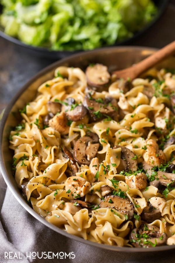 One Pan Chicken Stroganoff served family style with salad