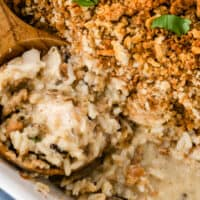 chicken and wild rice casserole with a spoonful in the dish with recipe name at bottom