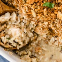 square image of chicken & wild rice casserole with a portion taken out to show creamy filling