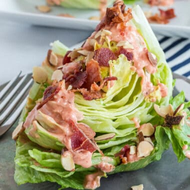Chipotle Tomato Wedge Salad recipe is a perfect salad with a kick. Crunchy lettuce, hearty toppings & spicy homemade dressing will be your new food craving!