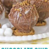 close up of chocolate chip cookie hot chocolate bombs on a plate with recipe name at bottom