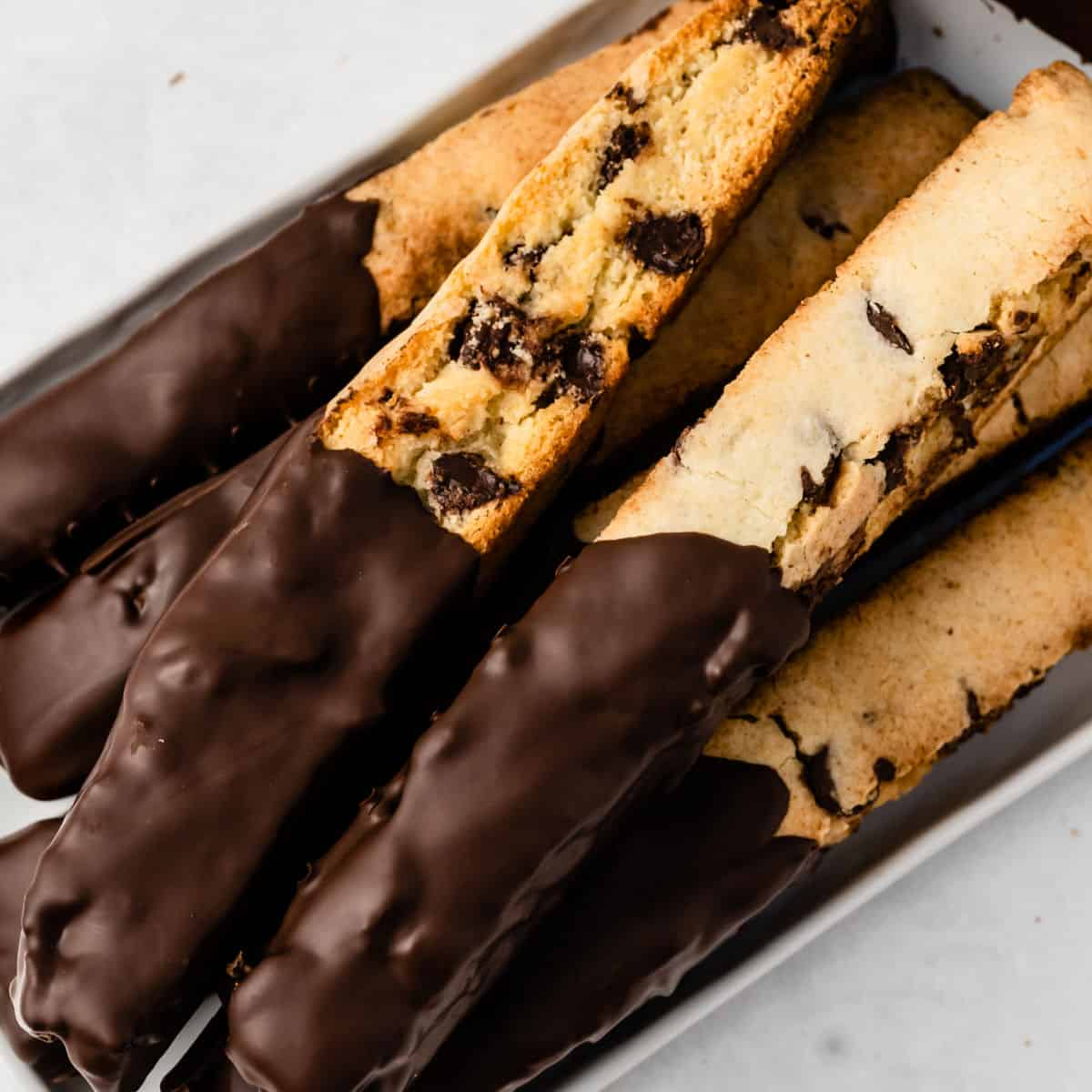 square image of chocolate chip and peppermint biscotti piled up on a platter