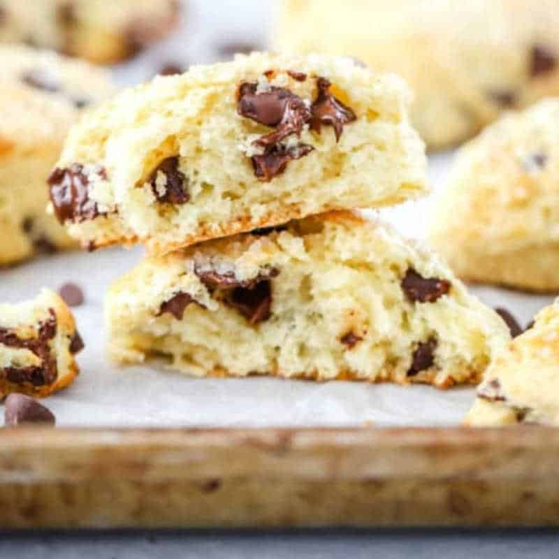 Clost up of the inside of a chocolate chip scone on a wooden board
