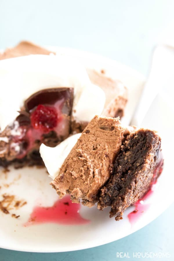 Chocolate Covered Cherry Cheesecake Brownie Bars aredecadently delicious. A no-bake cheesecake with a fudgy brownie base these bars are a real crowd pleaser!