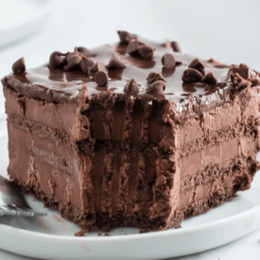 Easy chocolate icebox cake made with chocolate mousse, chocolate graham crackers, and chocolate ganache, is going to be your new favorite summer treat!