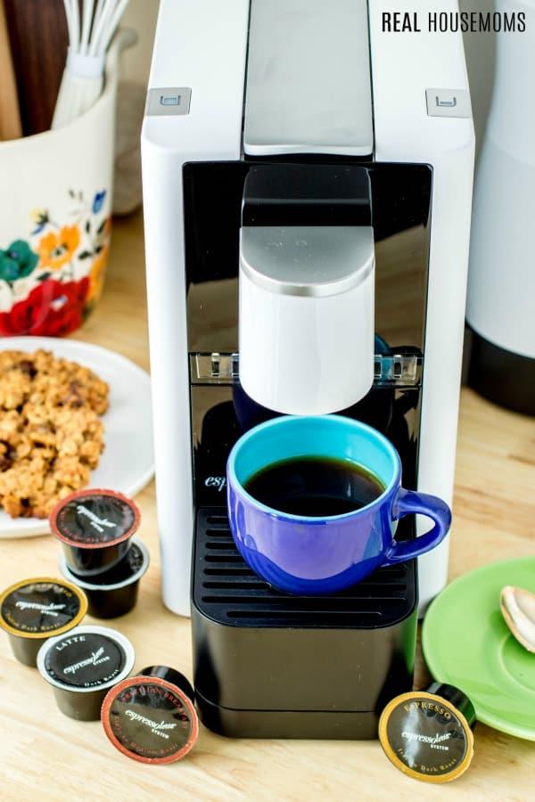 Espressotoria machine with a cup of freshly brewed espresso