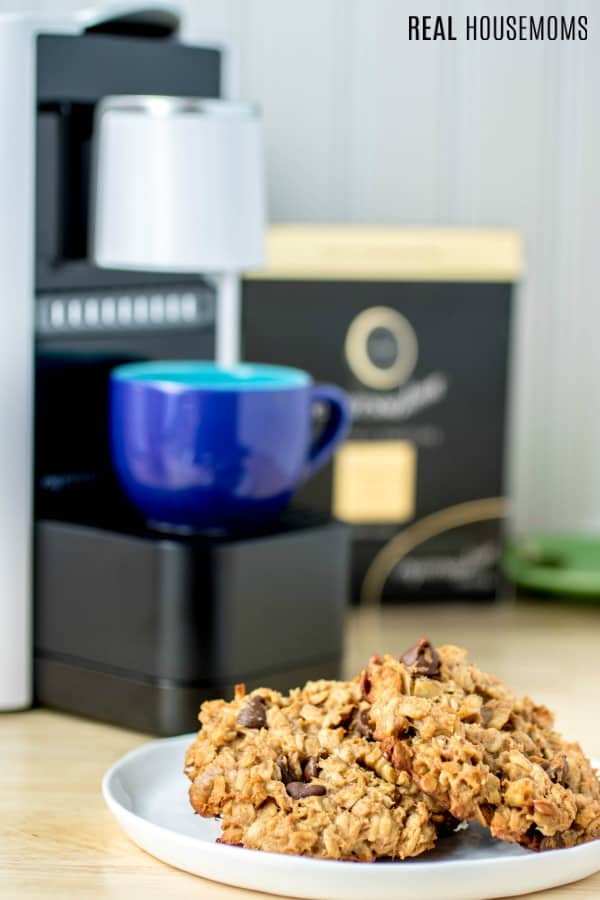 Chocolate Peanut Butter Banana Breakfast Cookies with Espressotoria machine and coffee cup