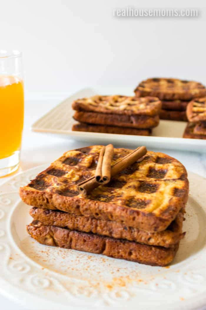 cinnamon french toast waffles on a plate with cinnamon sticks