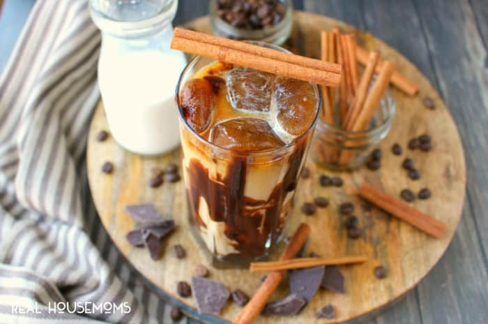 This amazing CINNAMON MOCHA ICED COFFEE is made with a deliciously simple cinnamon syrup, cold brew coffee, and topped off with chocolate syrup for an incredible drink that will be your new favorite way to start the day!