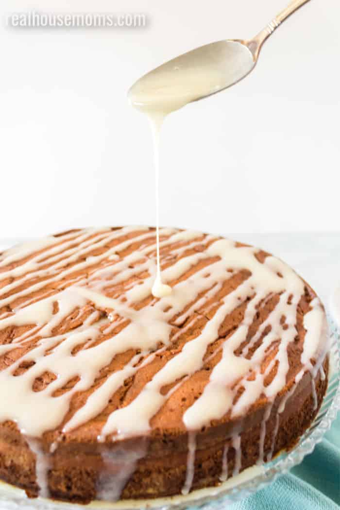 cream cheese glaze being drizzled onto coffee cake