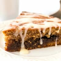 Cinnamon Roll Coffee Cake is the PERFECT sweet treat for breakfast or brunch! And that cream cheese glaze on top?! It'll be hard to say no to another piece!