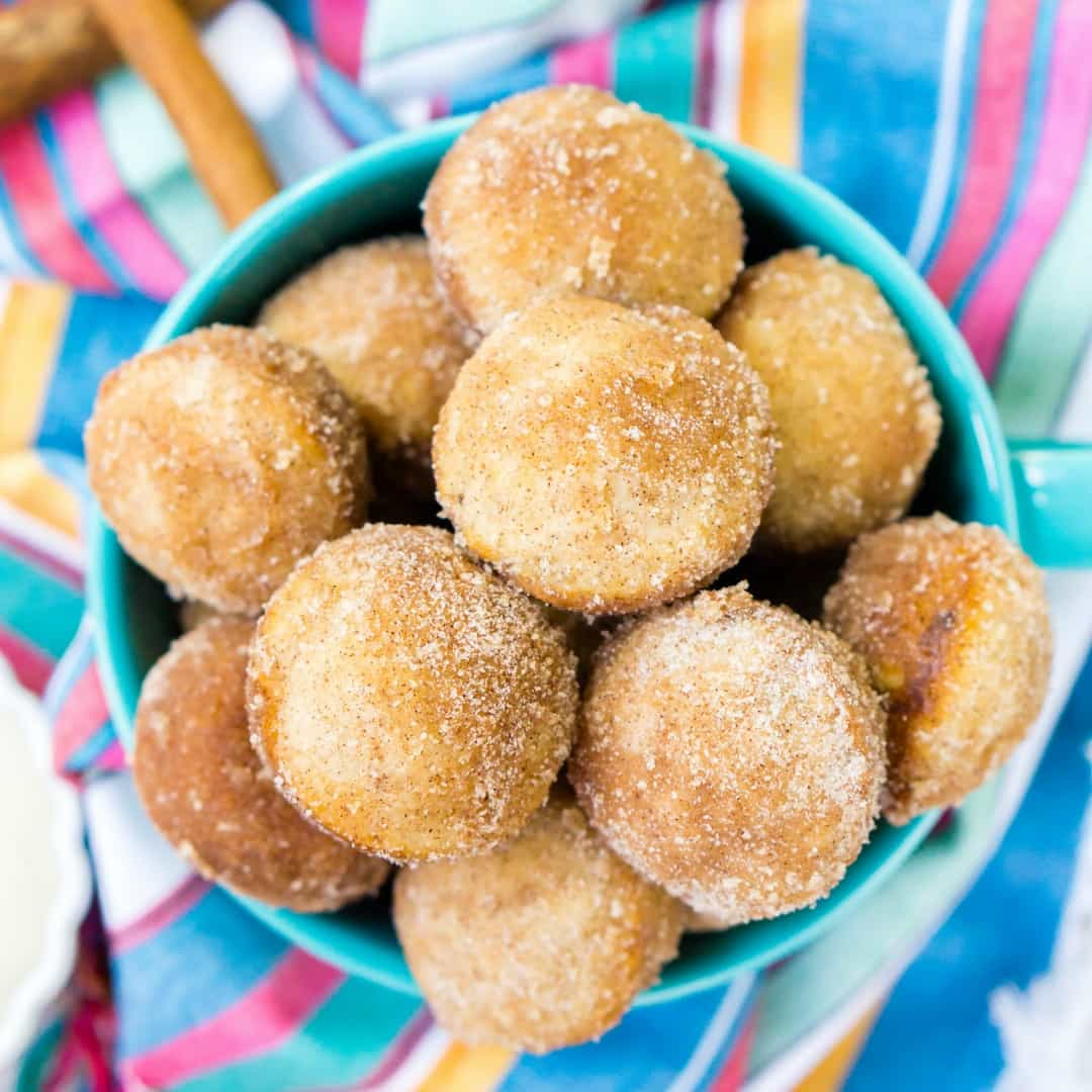 Cinnamon Sugar Donut Muffins are so easy to make at home! These baked breakfast bites are coated in butter, cinnamon, and sugar and taste like freshly fried donut holes!