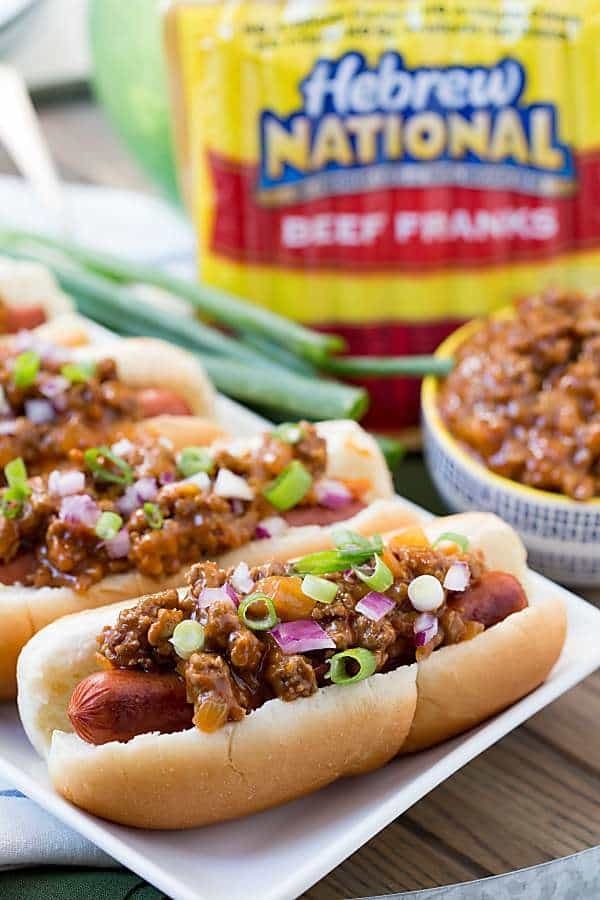 Nothing says game day food like Classic Chili Dogs! This chili has a tangy taste that goes perfectly with hot dogs! This easy game day recipe will make your friends happy!