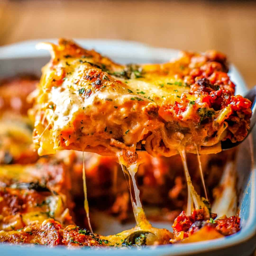Classic Easy Beef Lasagna is the perfect make-ahead meal to feed a crowd or quick dinner idea! Meat sauce, béchamel, pasta & cheese is a combo you'll crave!
