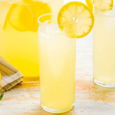 Classic Homemade Lemonade is the epitome of summer! Sweet, tart, and refreshing, it's perfect for lounging with friends on the porch, and backyard BBQs!