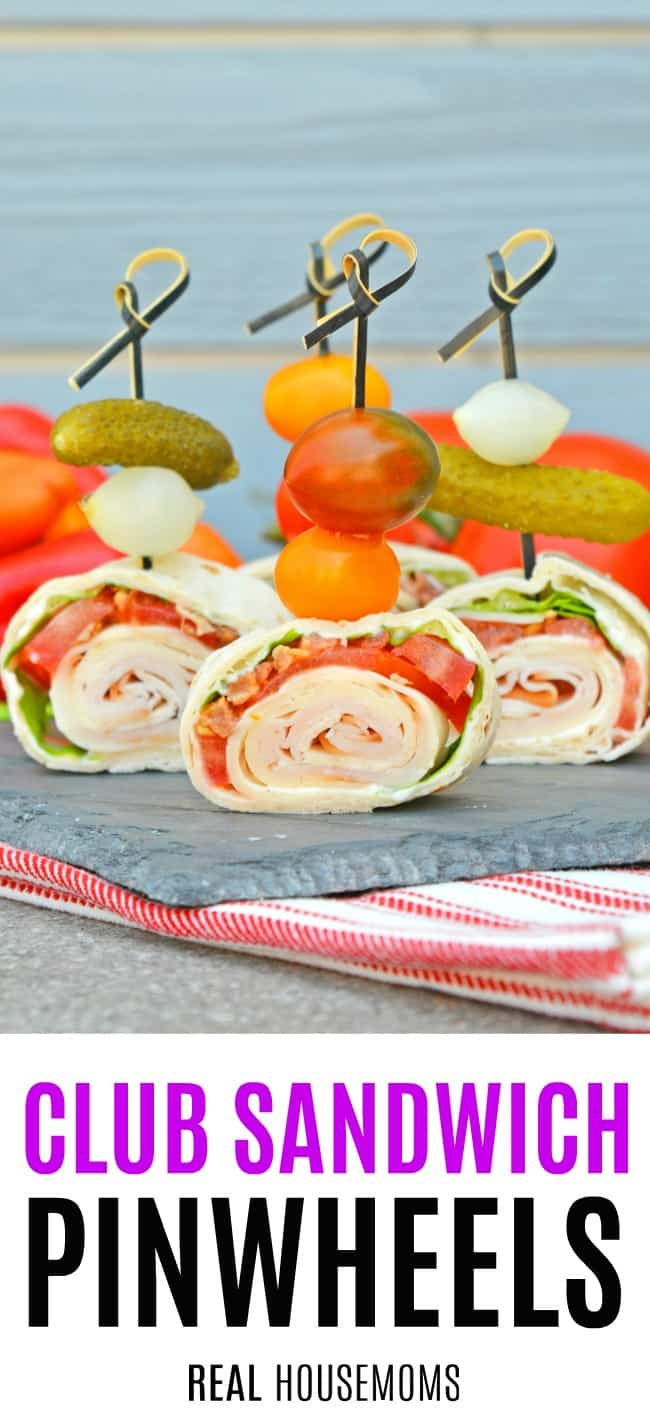 club sandwich pinwheels on a serving platter on toothpick skewers