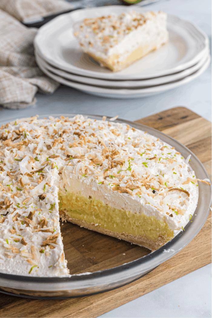 coconut cream pie with a slice missing to show the layers