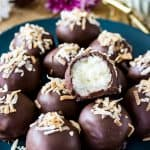 Sweet Coconut Cream Truffles made with just a few ingredients, cloaked in a dark chocolate shell, and topped off with toasted coconut!