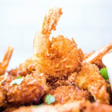 Crunchy Coconut Shrimp is always a crowd-pleasing appetizer! You're gonna love these juicy shrimp with a savory-sweet coconut crust & just a hint of heat!