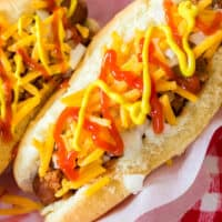 Coney Island Hot Dogs are perfectly cooked and topped with tasty homemade hot dog chili. This recipe is about as close to authentic as you'll get!