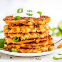 Corn Fritters are the perfect way to enjoy corn! You won't be able to resist the crispy little cakes loaded with sweet golden corn and lots of cheese!