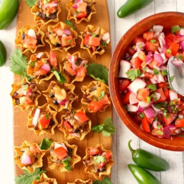 The perfect little nacho bite for every football party and home-gating event! Barbecue beef, beans, cheese and plenty of Pico de Gallo make these COWBOY NACHO BITES a fantastic appetizer everyone will love!