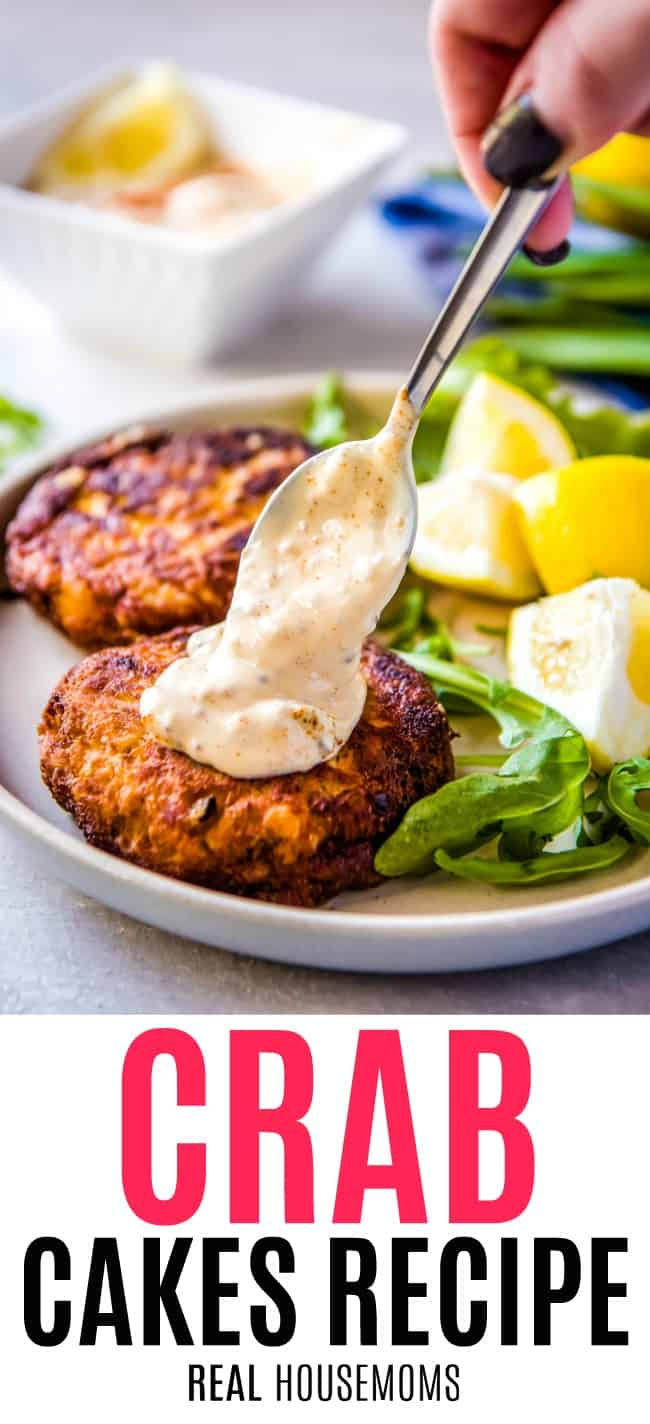 remoulade sauce being spooned onto crab cakes