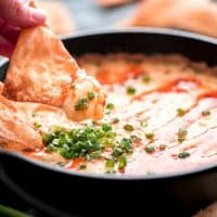 This Crab Rangoon Dip has all the elements of your favorite American-Chinese appetizer but is much easier to make. It's the yummiest start to your next holiday party!