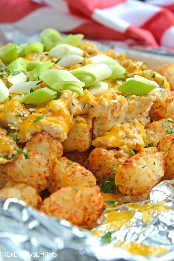 Crabby Totchos are crispy tater tots smothered with a creamy, Maryland style crab dip, cheddar cheese, scallions and Maldon Sea Salt. Perfect for a quick meal or entertaining!