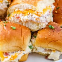 crack chicken sliders stacked up on a plate with recipe name at bottom