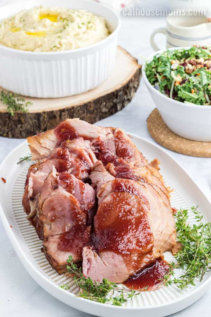 cranberry spiral cut ham served with mashed potatoes and salad