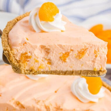 square image of a slice or creamsicle chiffon pie on a spatula over the rest of the pie