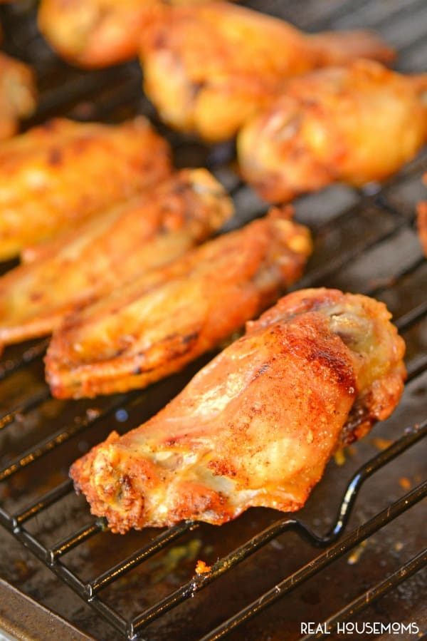 Crispy Baked Chicken Wings on a wire rack over a baking sheet, just out of the oven