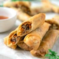Better than takeout, these Crispy Spring Rolls are full of the flavors you love! Cabbage, carrots, and mushrooms come together in these traditional Vietnamese fried spring rolls, and are the perfect complement to any Asian dinner!