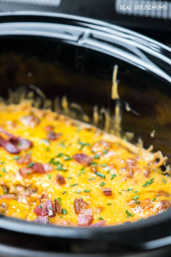 Crock Pot Bacon Cheeseburger Dip topped with diced bacon and chives