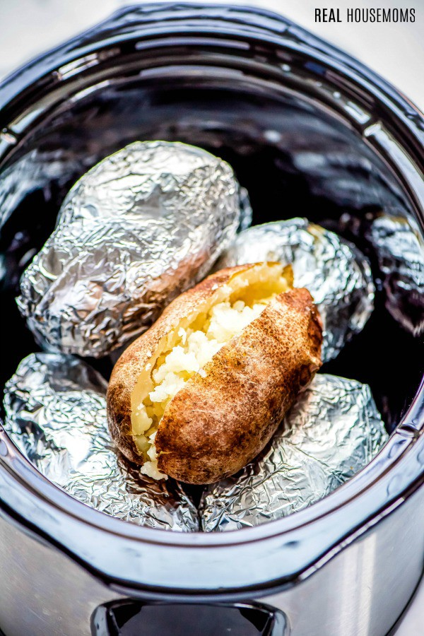 crock pot baked potatoes wrapped in foil in a slow cooker