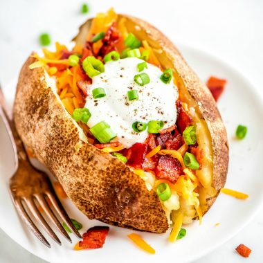 Crock Pot Baked Potatoes are the easiest way to cook a potato! Wrap them in foil & toss in the slow cooker for a delicious side that'll be ready for dinner!