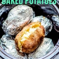 Image of baked potatoes in a crock pot most wrapped in foil one unwrapped and cut to show the inside