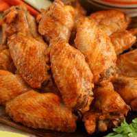 This CROCK POT CHICKEN WINGS RECIPE is the best way to get bold, spicy, fall-off-the-bone wings. You will never believe that they are cooked in a crock pot with just three ingredients!