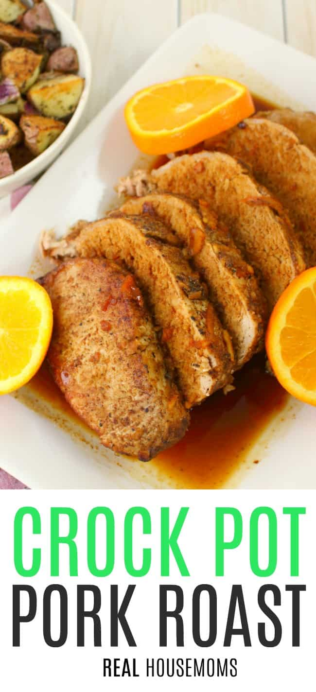 Crock Pot Pork Roast sliced on a serving platter with orange sauce spooned over the top and garnished with orange slices