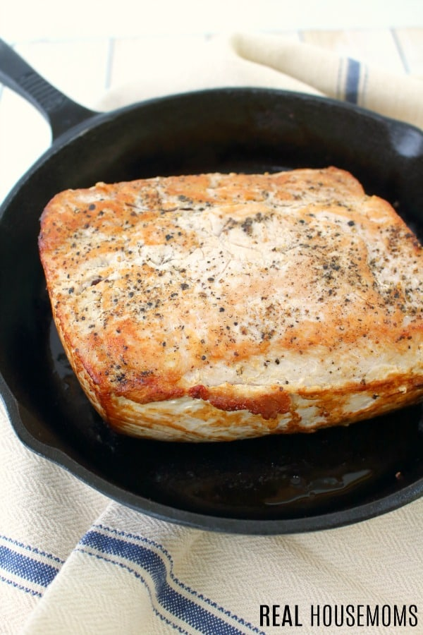 pork roast seared in a cast iron skillet