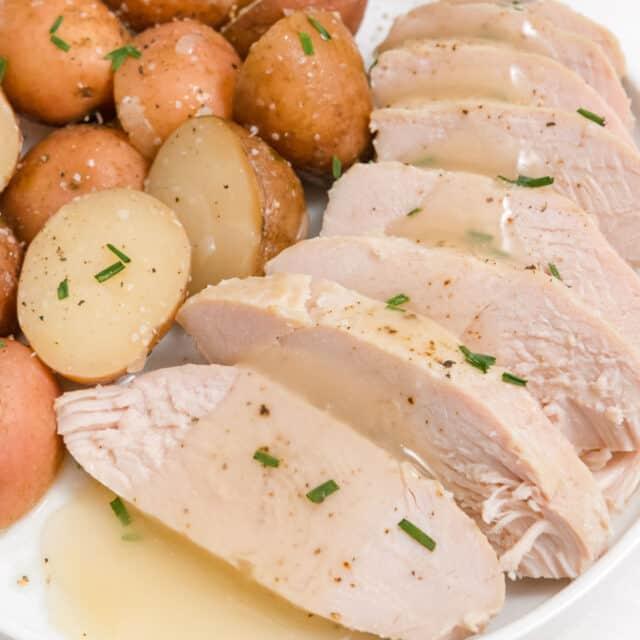 square image of sliced crock pot turkey tenderloin and potatoes