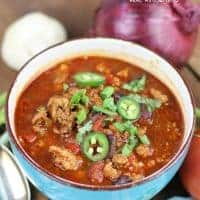 Weight Watchers Chili served in a soup bowl and topped with jalapeno slices