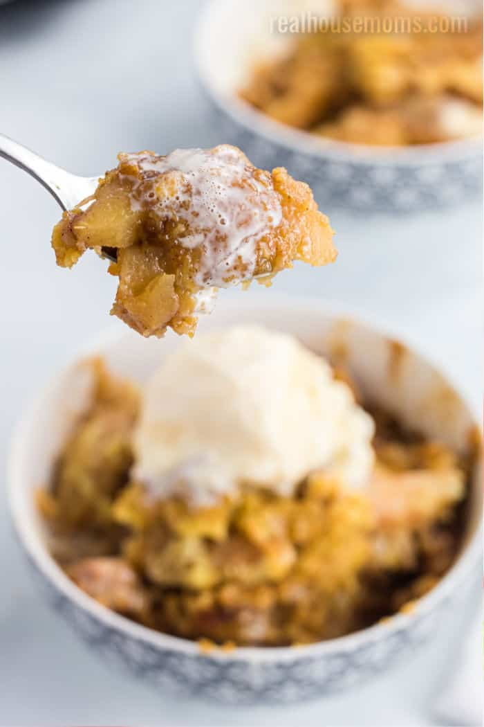 spoonful of apple cobbler over a bowl
