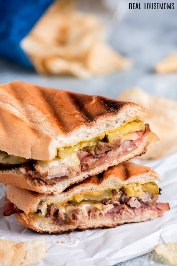 cuban sandwich cut in half and stacked to show the filling