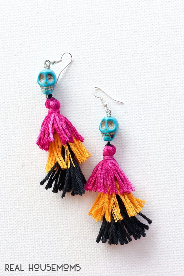 DIY Festive Skull Earrings with earrings tops added on