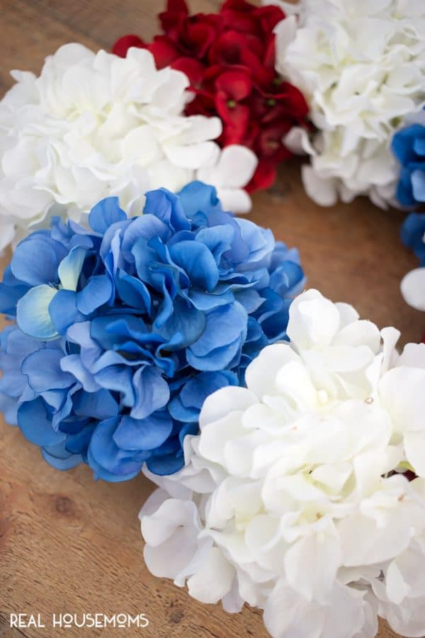 Front side of DIY Patriotic Wreath with alternating red, white, blue, and white hydrangea flowers