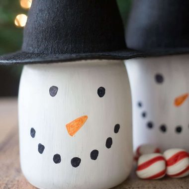 Perfect for Christmas crafting and gifting, create these adorable DIY Snowman Gift Jars!